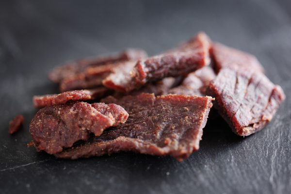 beef jerky in a pile on slate surface