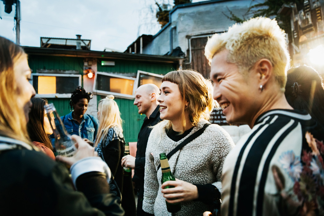 A group of people drinking together outside