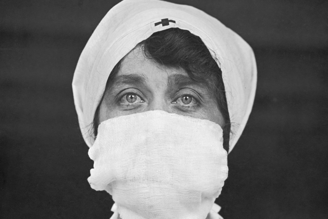 A Red Cross nurse wearing a face mask, c. 1918
