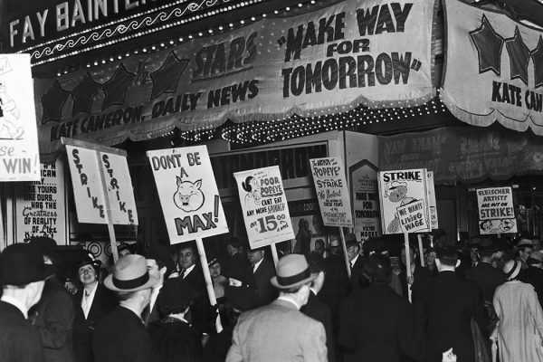 Employees of the Fleischer Studios picket the New Criterion Theater in New York to protest against the showing of Popeye and other cartoons drawn by striking Fleischer artists, 1937.