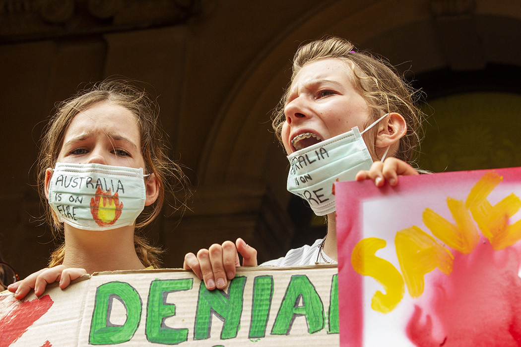 Young girls chant as activists rally for climate action at Sydney Town Hall on January 10, 2020 in Sydney, Australia.