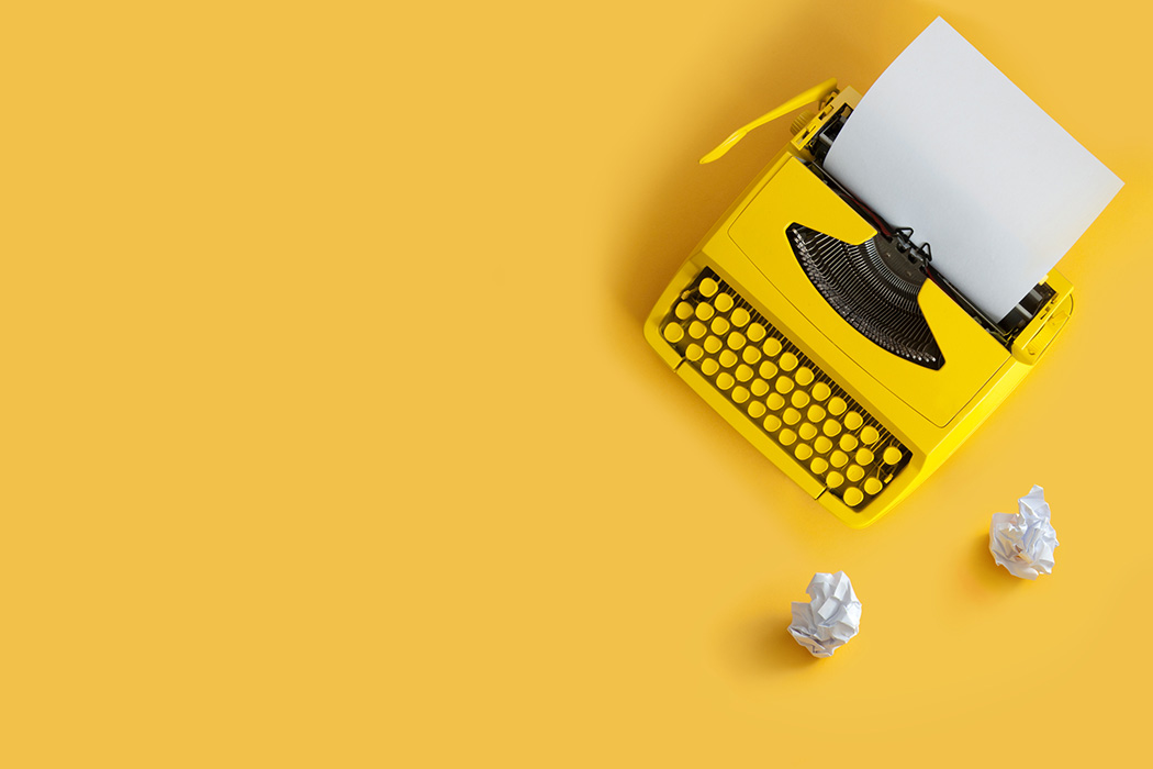 A typewriter on a yellow background