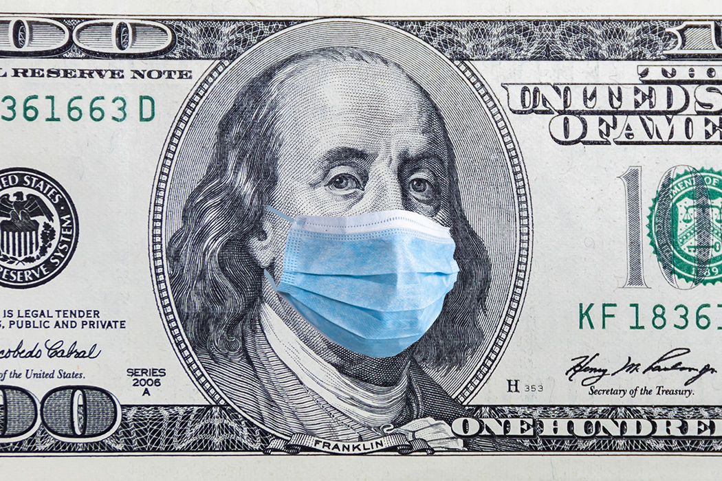 A 100 dollar banknote with medical mask.