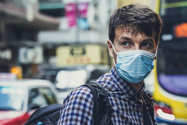 A man wearing a medical mask