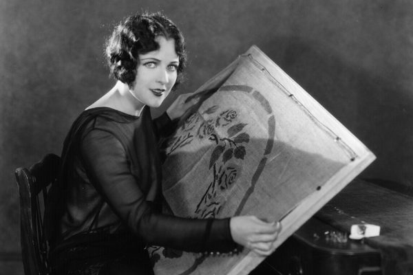 Hollywood film star and actress Jacqueline Logan preparing a rug pattern for embroidery, c. 1928