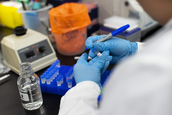 A researcher works in a lab that is developing testing for the COVID-19 coronavirus in New Jersey