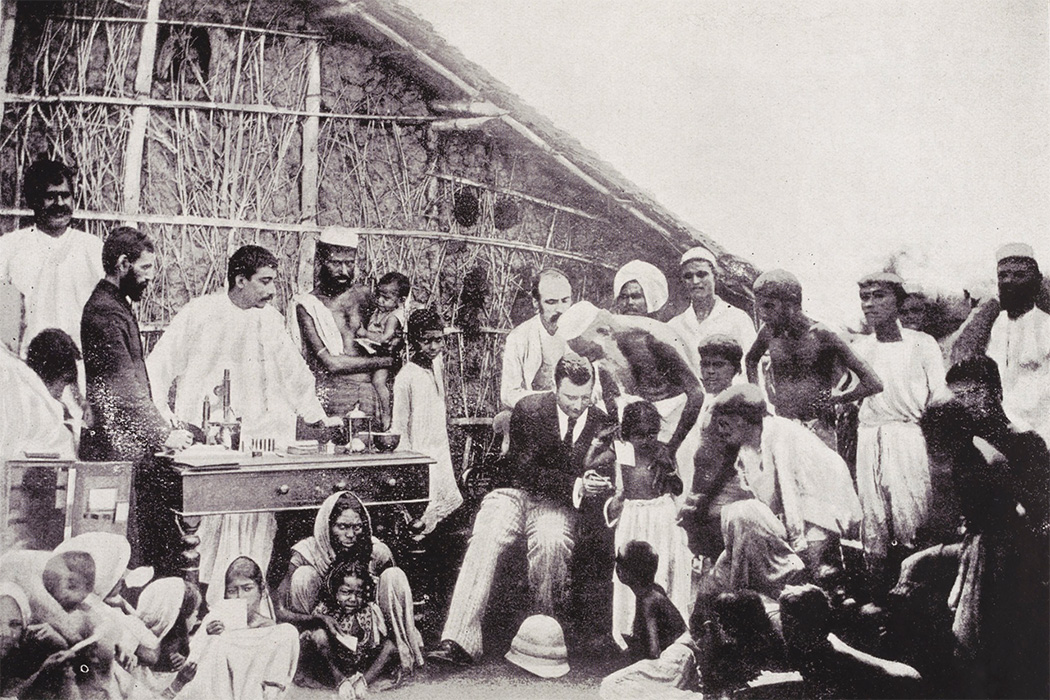 Photograph showing Waldemar Mordecai Wolffe Haffkine (1860-1930), Bacteriologist with the Government of India, inoculating a community against cholera in Calcutta, March 1894.