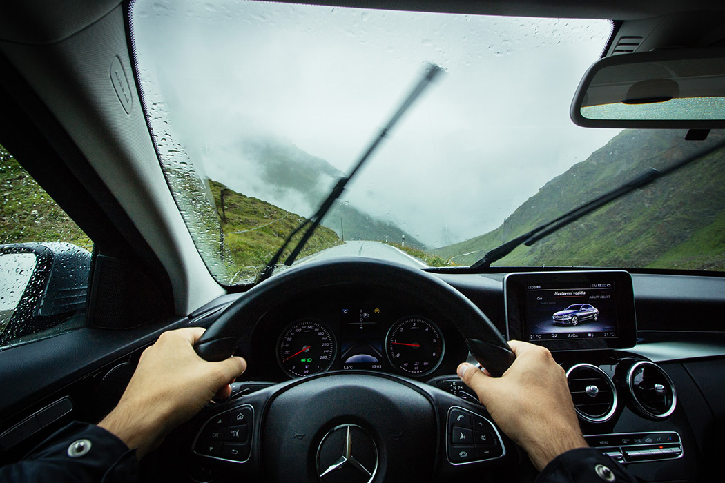 A person driving a Mercedes