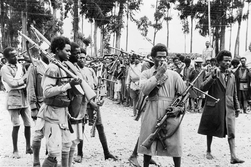 Ethiopian men gather in Addis Ababa, heavily armed with captured Italian weapons, to hear the proclamation announcing the return to the capital of the Emperor Haile Selassie in May 1941