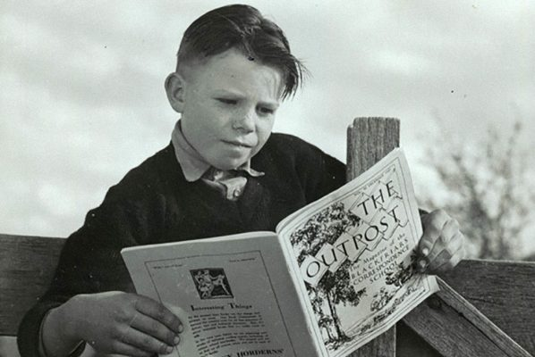 A student reading a correspondence school magazine, 1946