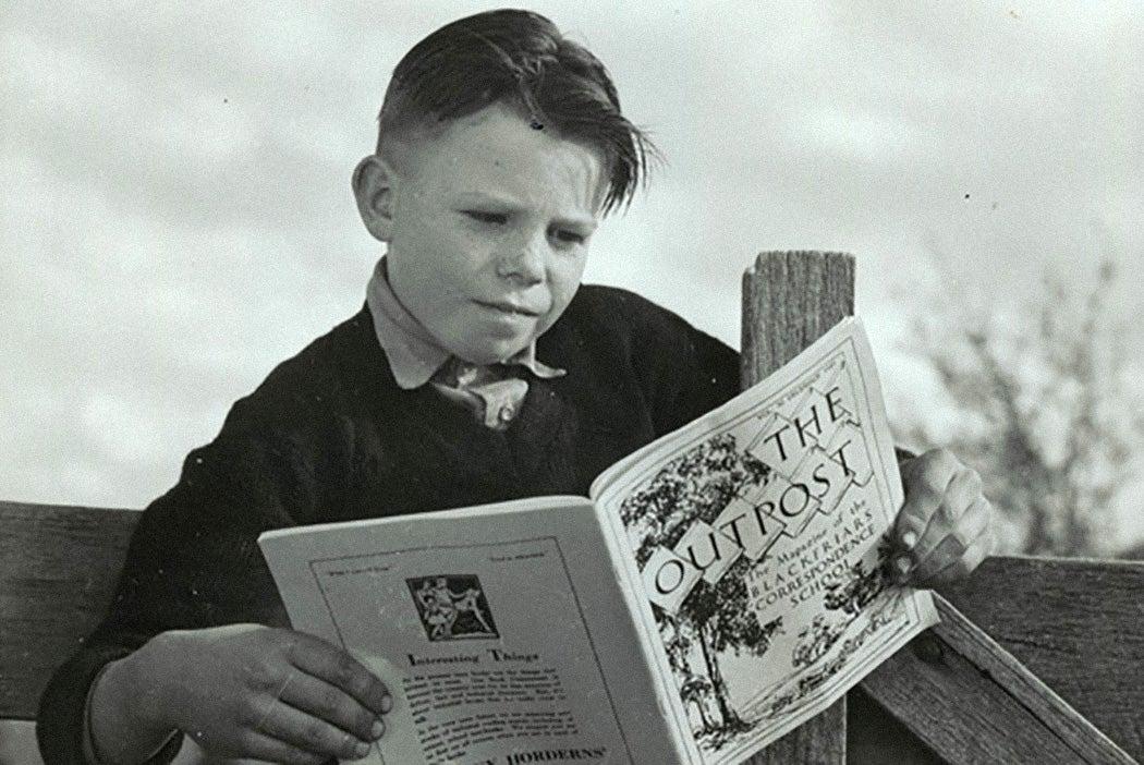 A student reading a correspondence school magazine, 1946