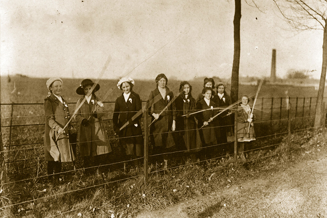Girls' Beating the Bounds' at a fence near St Albans in Hertfordshire, 1913