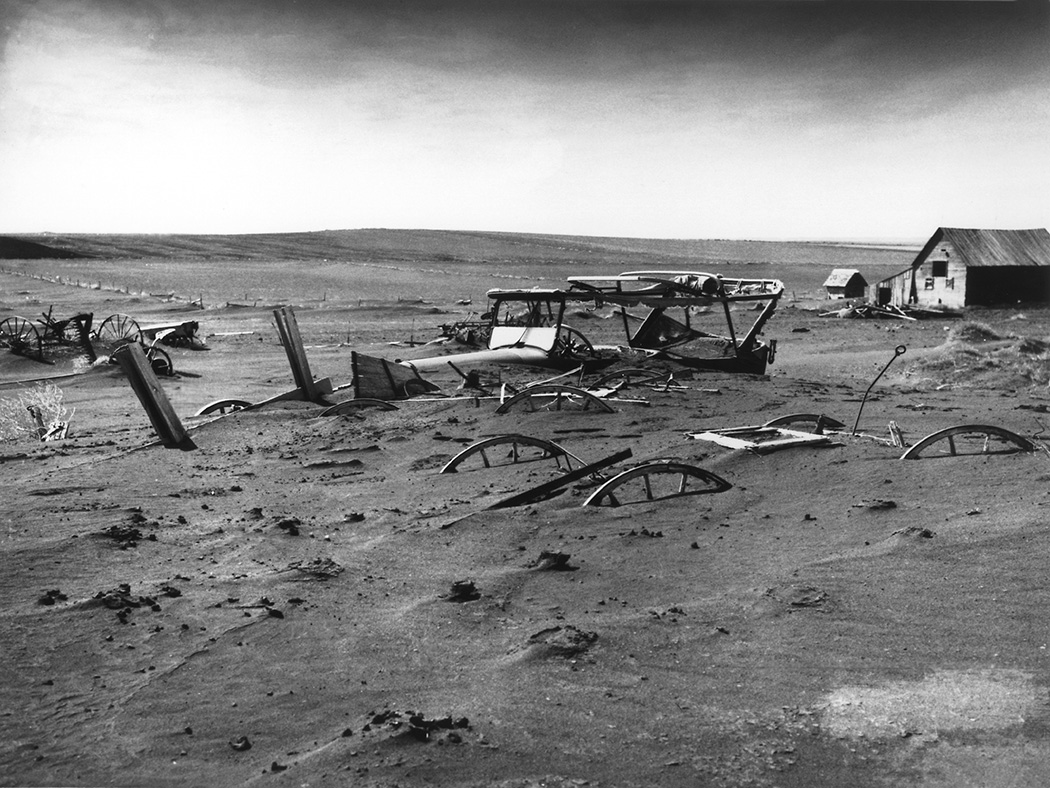 Buried machinery in barn lot in Dallas, South Dakota, United States during the Dust Bowl, 1936