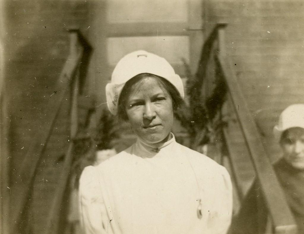 An unidentified nurse poses for a portrait, early 1900s