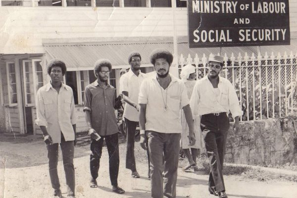 Walter Rodney and W.P.A members exit the Ministry of Labour & Social Security, Guyana - 1970s