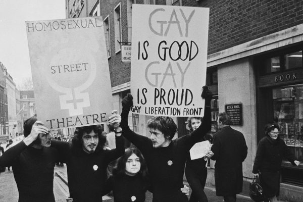 Members of the United Kingdom branch of the Gay Liberation Front carry placards during a street protest along Essex Street in London on 12th February 1971.