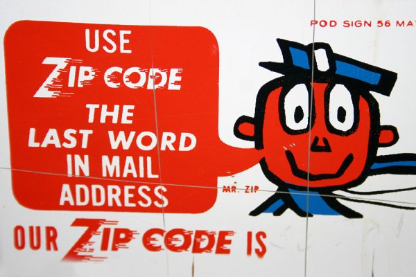 "ZIP code promotional sign with ""Mr. ZIP"" on a hotel letter drop."