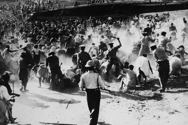 South African police beating Black women with clubs after they raided and set a beer hall on fire in protest against apartheid, Durban, South Africa, 1959