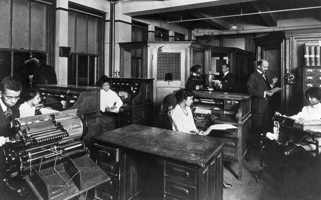W E B Du Bois (right) at the headquarters of the NAACP publication 'Crisis' as his production staff work at their desks, c. 1932