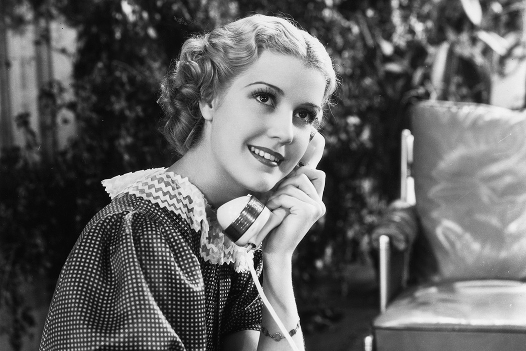 Anita Louise chats on the telephone in a scene from The Gay Lady, 1935