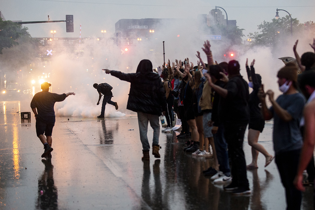 ear gas is fired at protesters demonstrating against the death of George Floyd outside the 3rd Precinct Police Precinct on May 26, 2020 in Minneapolis, MN.
