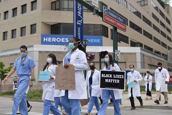 Several hundred doctors, nurses and medical professionals come together to protest against police brutality and the death of George Floyd on June 5, 2020 in St Louis, Missouri.