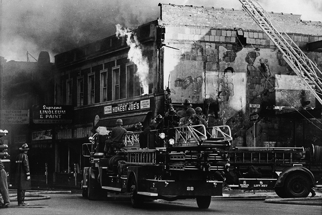 Federal troops ride on a fire engine to protect the firefighters from snipers during the riots in Detroit, Michigan, July 27, 1967