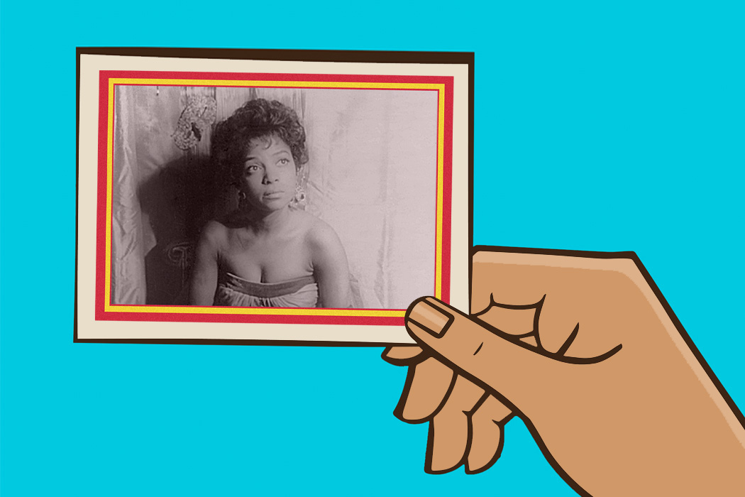 A hand holding a trading card featuring Ruby Dee