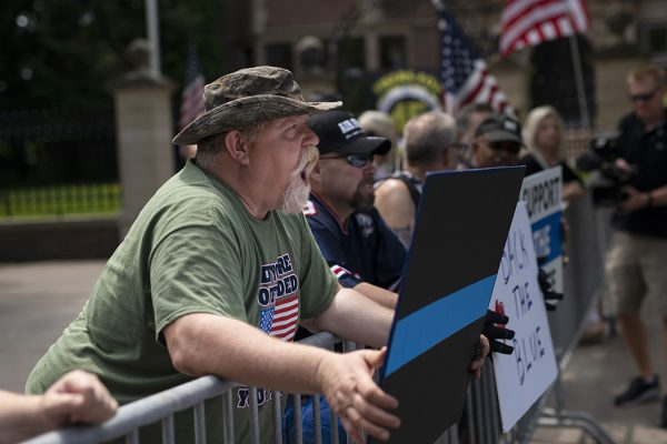 Pro-police demonstrators argue across a temporary barricade during a protest outside the Governors Mansion on June 27, 2020 in St Paul, Minnesota.