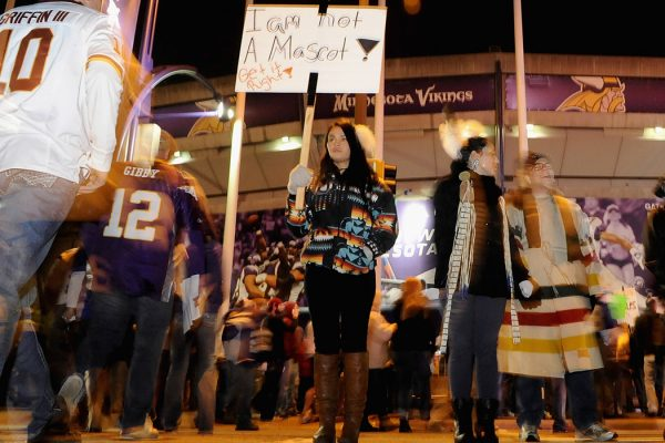 Raven Ziegler from Minneapolis protests the name of the Washington Redskins before a game on November 7, 2013