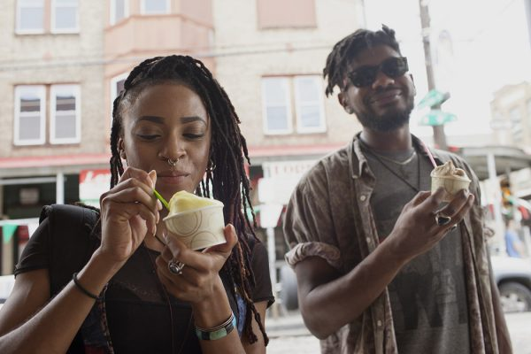 A young man and woman eating ice cream.
