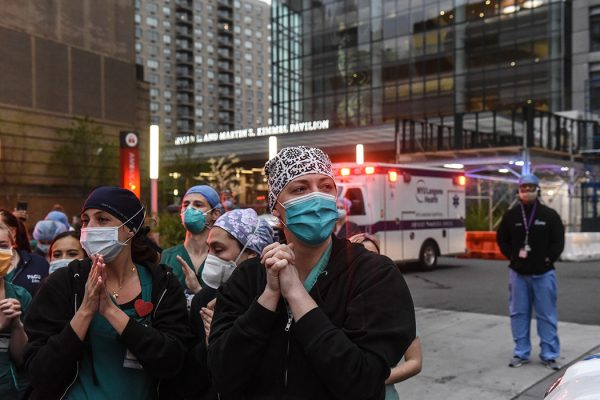 Nurses react as community members applaud them on April 30, 2020 at NYU Langone Hospital in New York City.