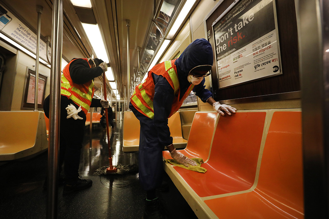 Workers clean a station as the New York City subway system is closed for nightly cleaning due to the continued spread of the coronavirus on May 07, 2020 in New York City.