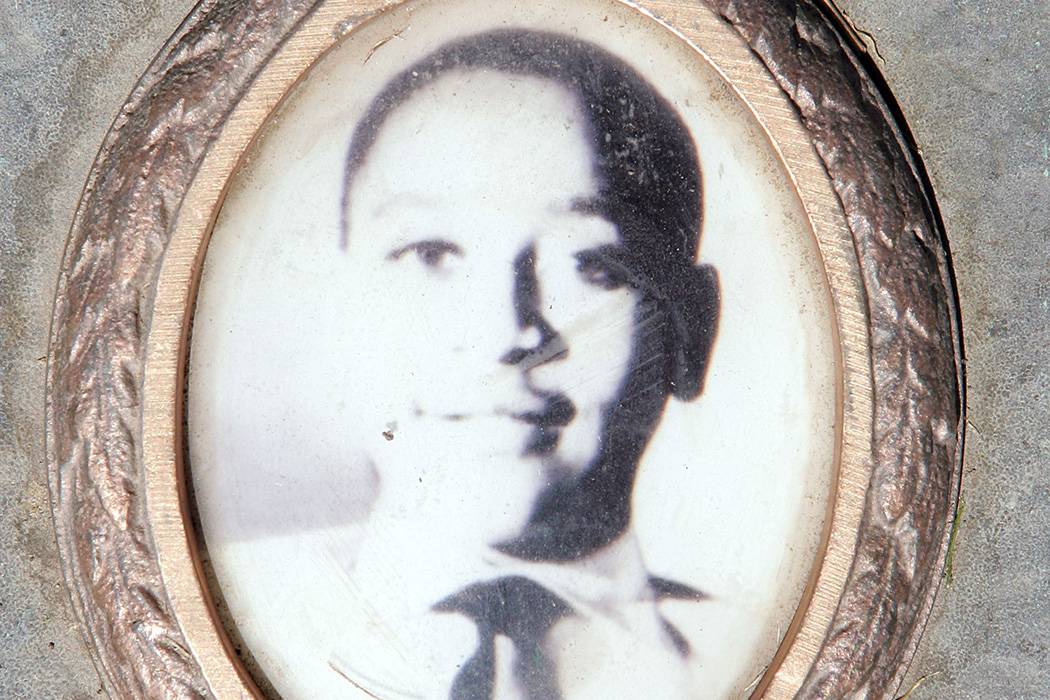A photo of Emmett Till is included on the plaque that marks his gravesite at Burr Oak Cemetery in Aslip, Illinois.