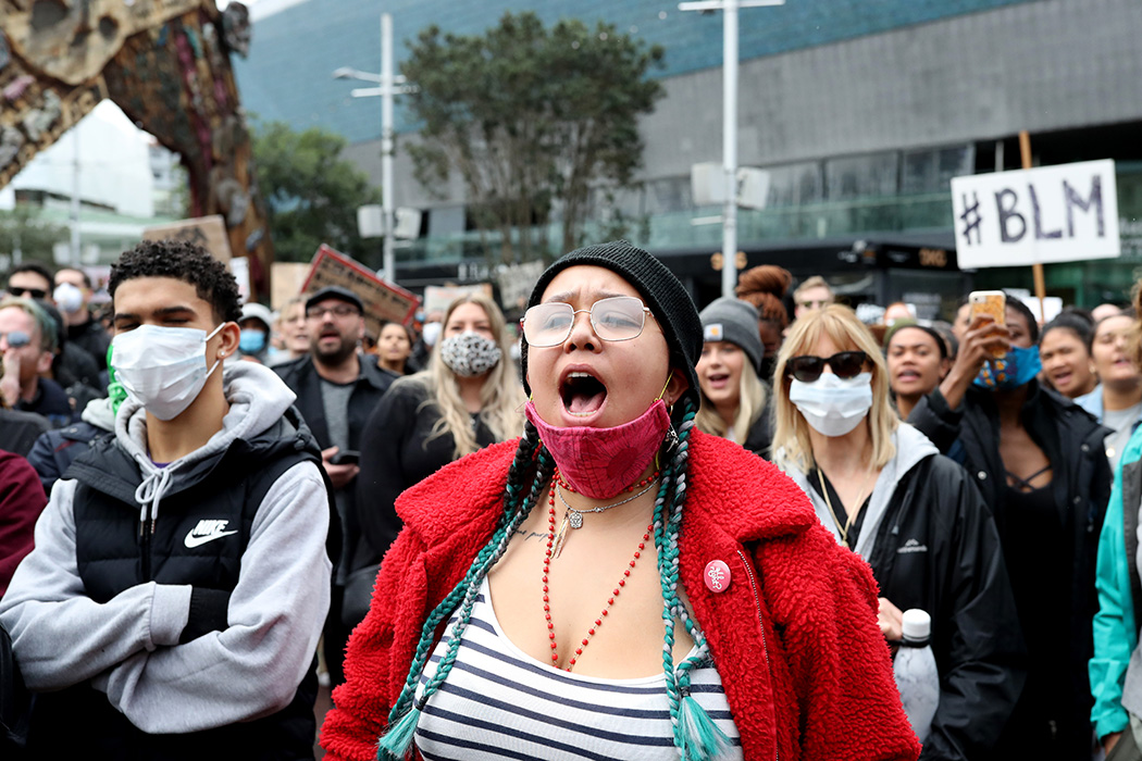 Protesters march down Queen Street on June 01, 2020 in Auckland, New Zealand.