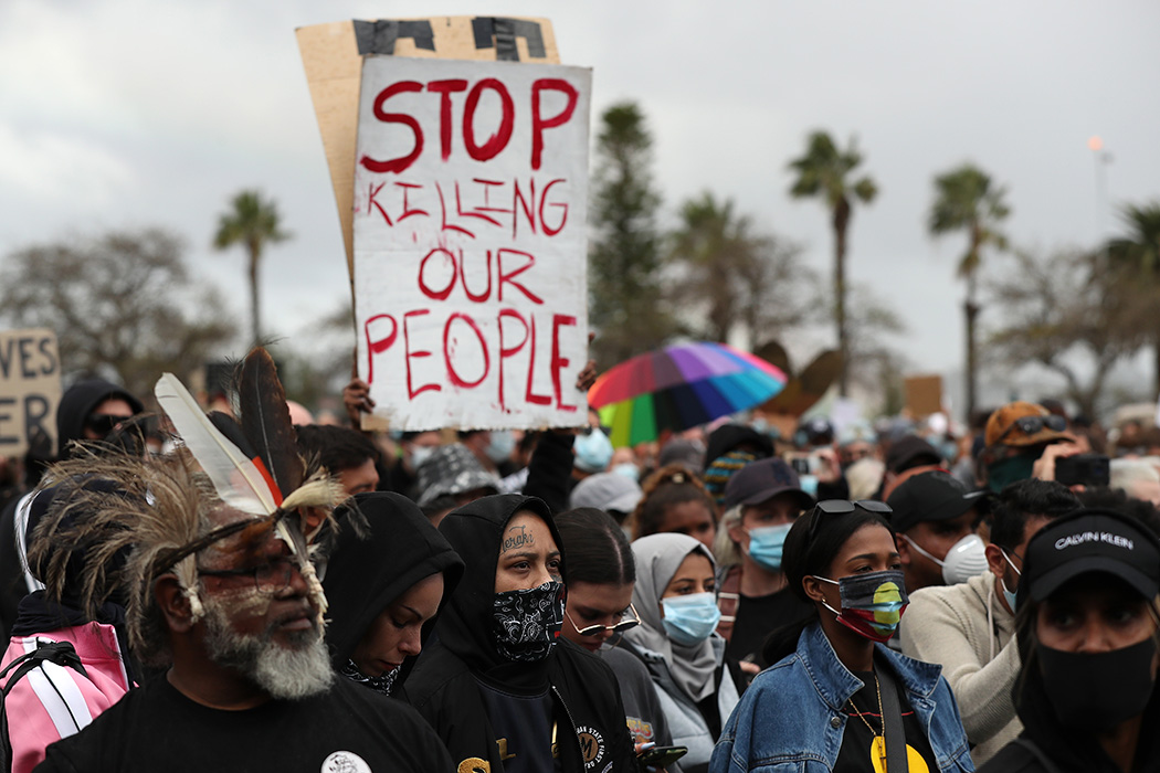 Protesters show their support during the Black Lives Matter Rally at Langley Park on June 13, 2020 in Perth, Australia.
