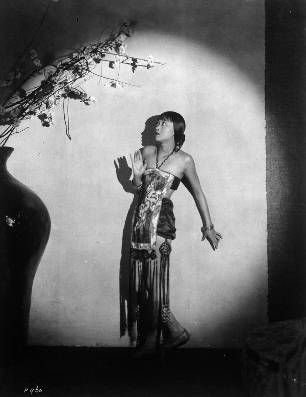 Anna May Wong surrounded by ominous shadows, c. 1930