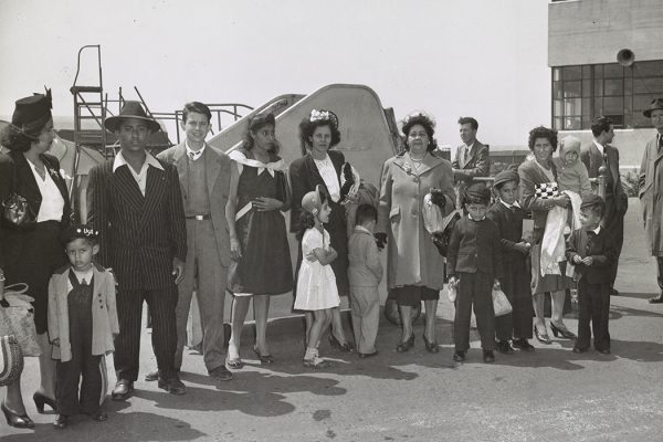 A group of Puerto Ricans at Newark airport, who just arrived by plane from Puerto Rico waiting to be transported to New York, 1947