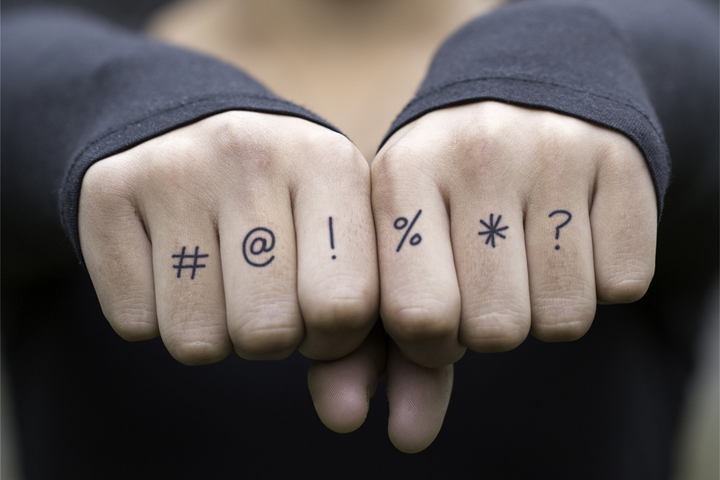 Tattoos on a person's knuckles