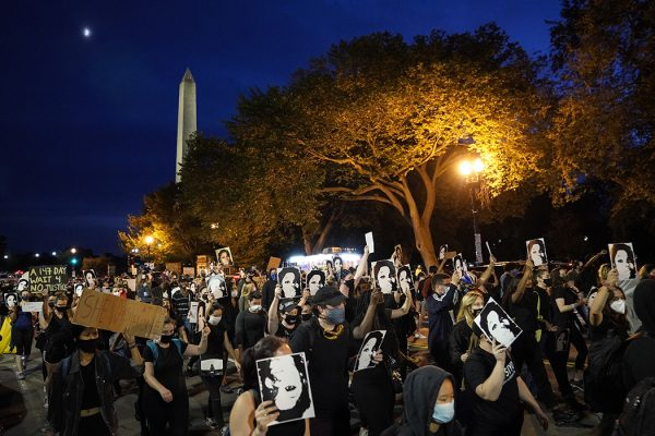 Demonstrators march near the White House in protest following a Kentucky grand jury decision in the Breonna Taylor case on September 23, 2020