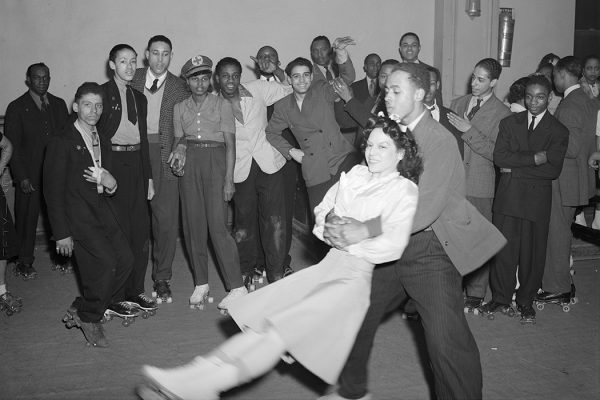 A man swinging a woman on roller skates, Savoy Ballroom, Chicago, Illinois