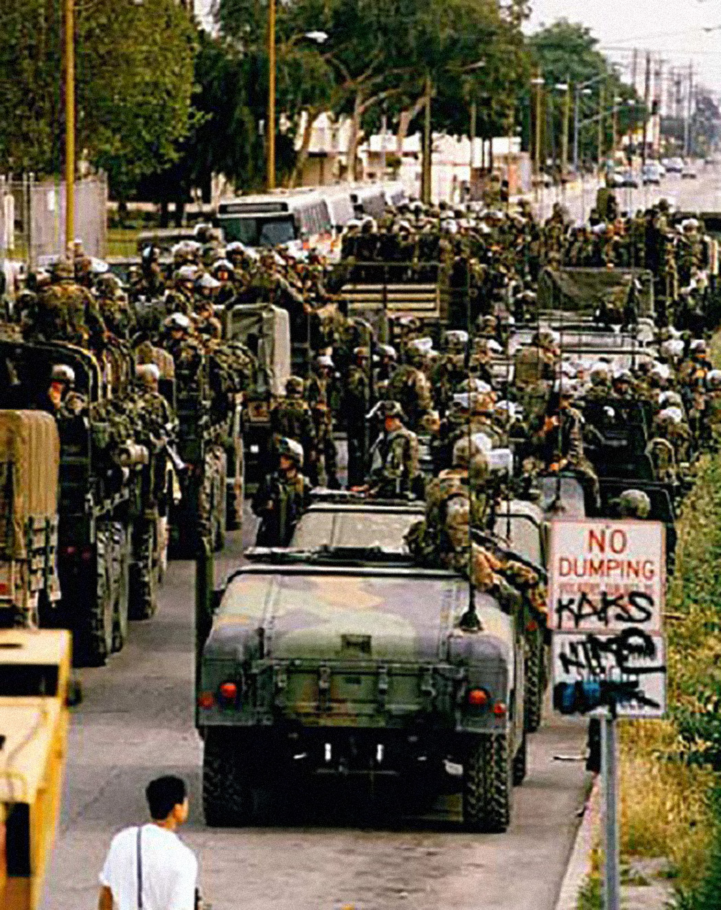 Marines disembark from their Humvees in Compton during the L.A. riots, 1992