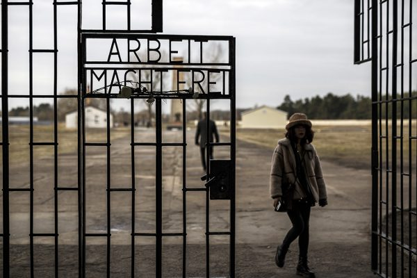 Visitors walk past the entrance gate to the Auschwitz death camp, the most notorious of the many Nazi concentration camps