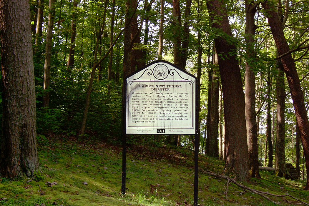 A historical marker for the Hawks Nest Tunnel disaster
