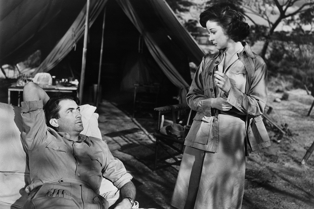 Gregory Peck looking up at Susan Hayward in a scene from the film 'The Snows Of Kilimanjaro', 1952.