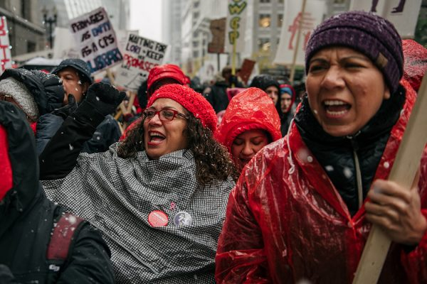 Photograph: Thousands march through the streets near City Hall during the 11th day of an ongoing teachers strike on October 31, 2019 in Chicago, Illinois.   Source: Getty