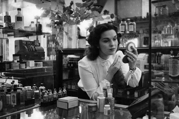 A sales assistant at the perfume counter of a department store, 1946