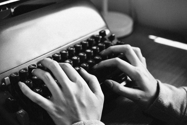 A woman typing on a typewriter