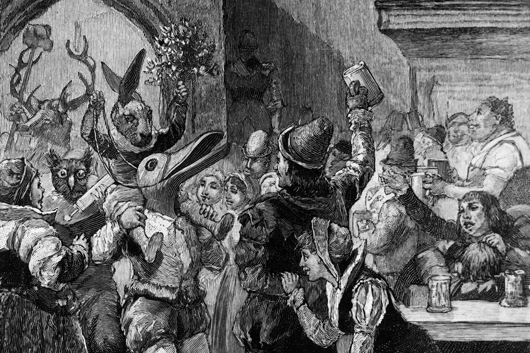 A troupe of mummers in animal costumes performing in a Medieval Baronial Hall at Christmas, c. 1500