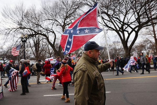 "A man holding a confederate flag at the ""Stop the Steal"" rally on January 06, 2021 in Washington, DC."